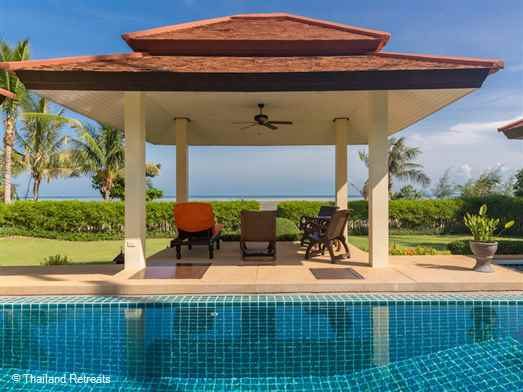 Baan Tawan Chai is a Koh Samui beachfront villa situated in a tranquil and beautiful environment on Laem Set beach on the tranquil coast. Open plan living leading to lawned gardens, a super pool and the beach on your doorstep. Offers rates for 3 bedroom and 4 bedroom occupancy (certain dates).