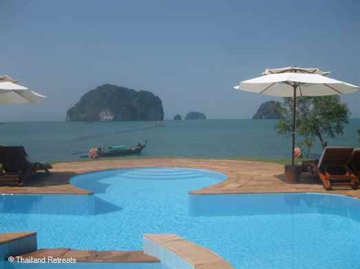 An oceanfront villa facing Phang Nga bay with private man made beach area and a pier for long tail trips to the islands