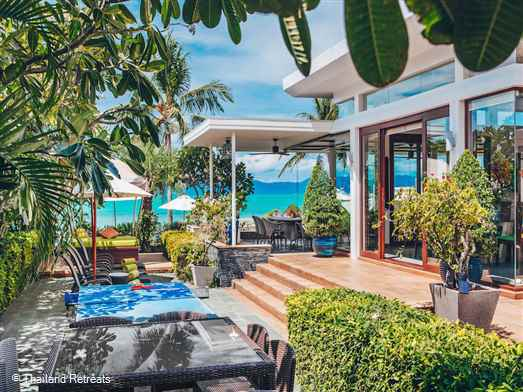 The Lotus Beach Villa is a stylish luxury Koh Samui villa located on a beautiful beach in a small secure beach resort with stunning views to Koh Phangan. Has it's own gym, a pool table, private lap pool as well as resort pool. Offers rates for 3, 4 and 5 bedroom occupancy.