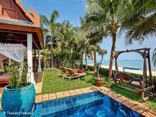 Villa Bougainvillea is luxury beachfront Koh Samui villa set directly on Maenam beach on an exclusive Estate. Beachside sala with 4 poster daybed, lap pool and lawned gardens. Offers rates for 2 bedroom and 4 bedroom occupancy.