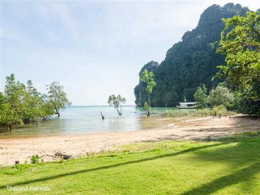 Krabi Beach House with it's private swimming pool is located close to the town of Ao Nang and a perfect holiday villa to stay in whilst exploring what amazing Krabi has to offer. This waterfront villa is ideal for family gatherings or with groups of friends. A sandy beach is at the end of the lawned garden and complimentary kayaks are available for guest use.