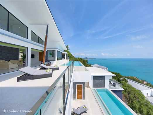 Karpe Diem is a stunning contemporary style Koh Samui villa located in the hills above Chaweng Noi. Close to the lively towns of Chaweng and Lamai. Features include 2 x infinity edge pools, panoramic views, 5 minutes drive from 2 beach coves.