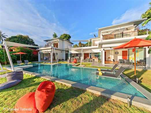 A modern, beautiful and spacious 5 bedroom beachfront Koh Phangan villa with private swimming pool and stunning west facing ocean views embracing the outdoor tropical living. Located just a few km from the main town and pier of Thong Sala