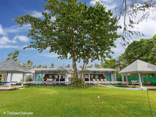 Twin Villas Natai are 2 elegant 5 bedroom connecting villas fronting 10-kilometre stretch of sand on the Andaman coast.  Optional connecting living area pavilions for joint socialising create two 12 swimming pools and a super shared lawn area perfect hosting a wedding or event.