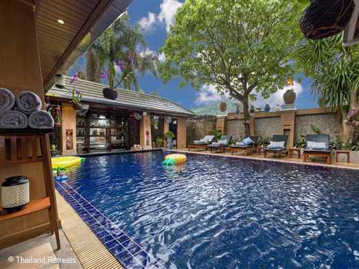 "<p>Talay NaiHarn Villa is an expansive 8 bedroom villa and features 2 swimming pools, fitness /games room with snooker table/ cinema room, steam/sauna and massage room.</p>  <p>Located approximately 2 km from beautiful Nai Harn Beach the villa can accommodates 24 persons+ in 2 buildings.&nbsp;&nbsp;<span style=""color: #000080;"">Rates for 5 and 8 bedroom occupancy available.</span></p>"